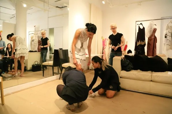 Jessica Stam trying on shoes for Marchesa spring summer 2013 fashion show
