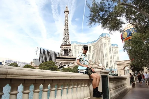 Bryanboy at Bellagio fountain with Eiffel Tower in the background