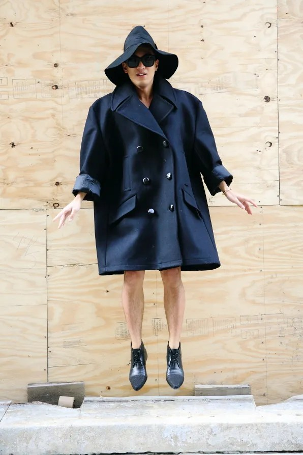 Bryanboy in a black Margiela x H&M coat