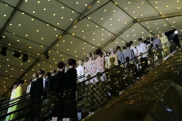 Army of models going up the escalator at the Louis Vuitton spring summer 2013 fashion show
