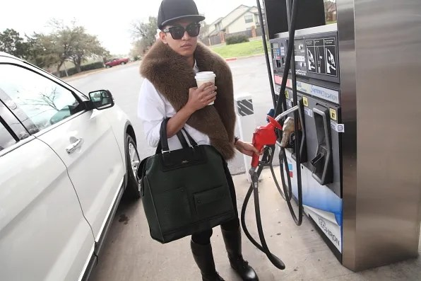 Bryanboy pumping gas in Austin, Texas