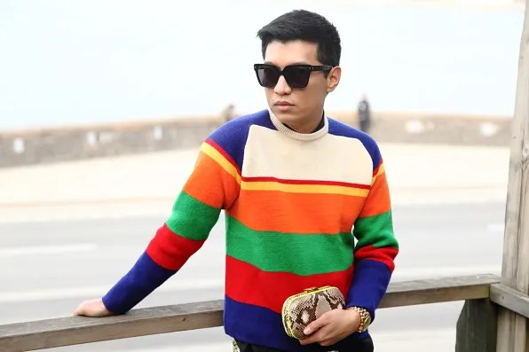 Bryanboy in Sodermalm carrying a Corto Moltedo snakeskin clutch bag