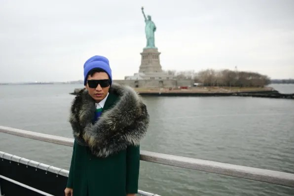 Bryanboy in front of the Statue of Liberty on Liberty Island, New York
