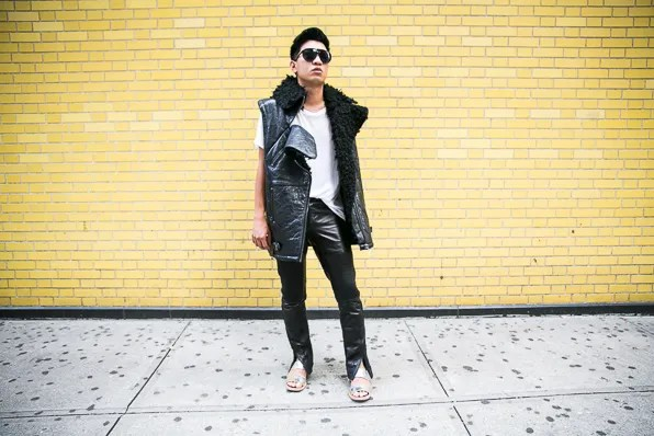 Bryanboy wearing a faux shearling vest, white shirt and leather pants from H&M's Paris Runway collection