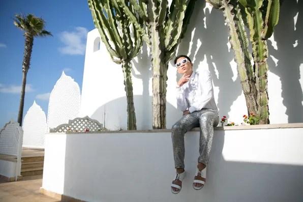 Bryanboy wearing white Prada sunglasses at the L'Amphitrite Palace, Skhirat, Morocco