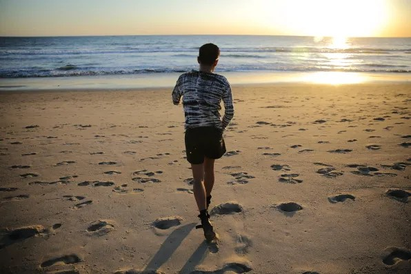 Bryanboy running along Santa Monica beach