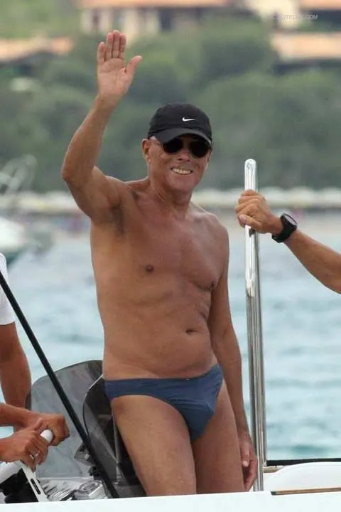 Giorgio Armani in swimming trunks photo.