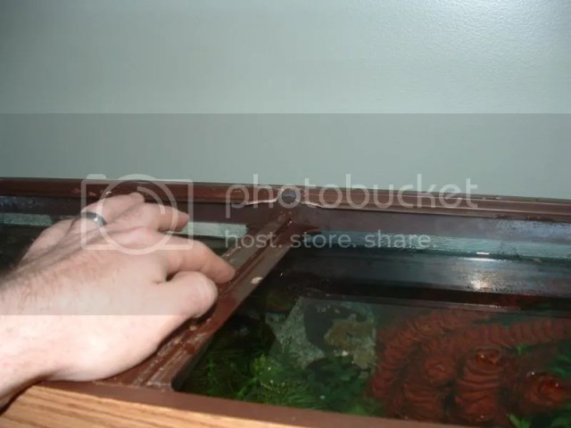 : Awesome article on replacing the center Brace on a 55 Gallon tank