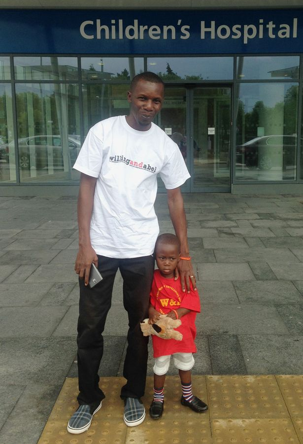 Ethan Suglo from Ghana, with his father Charles