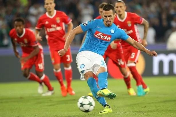 Napoli's Arkadiusz Milik scores his team's third goal from the penalty spot