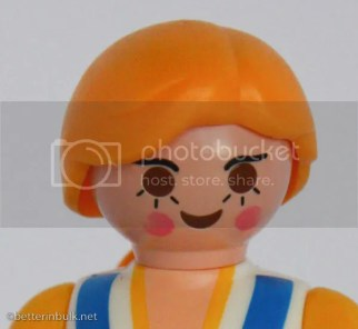 zoomed in Playmobil doll at ISO 1600