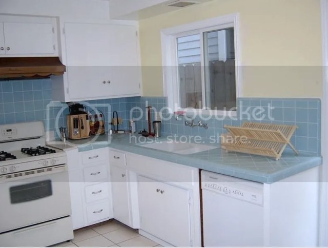 mid century blue tile kitchen counter with beige paint