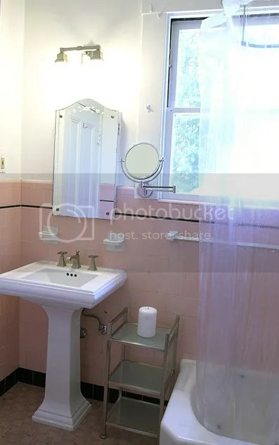 ... pink bathroom tile in 1930s bathroom with mosaic floor and white paint