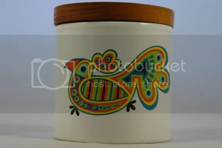 vintage storage jar with colourful parrot decoration