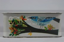 vintage biscuit tin with colourful bird decoration