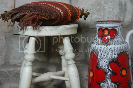 West German vase with rustic stool and knitted cushion