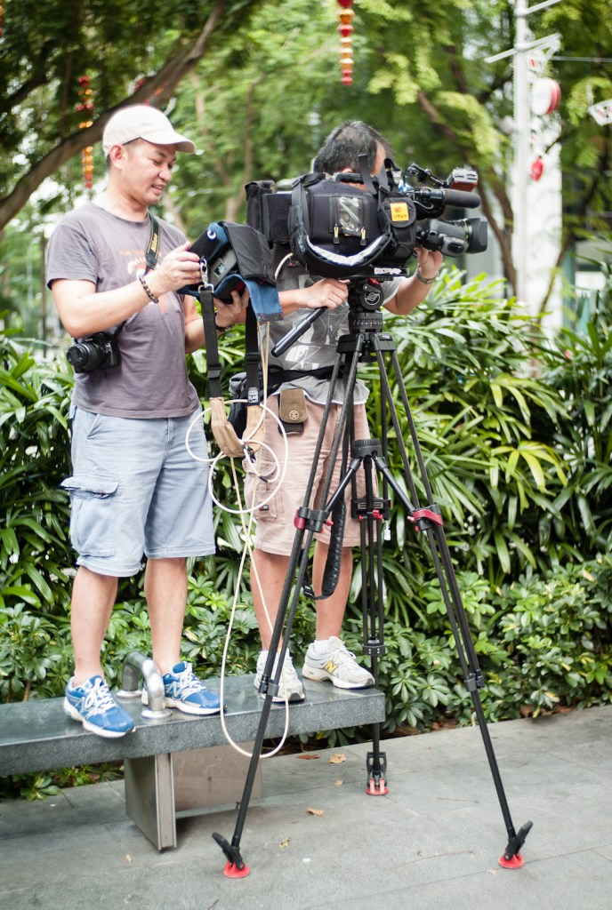 Video crew at work along Orchard Road