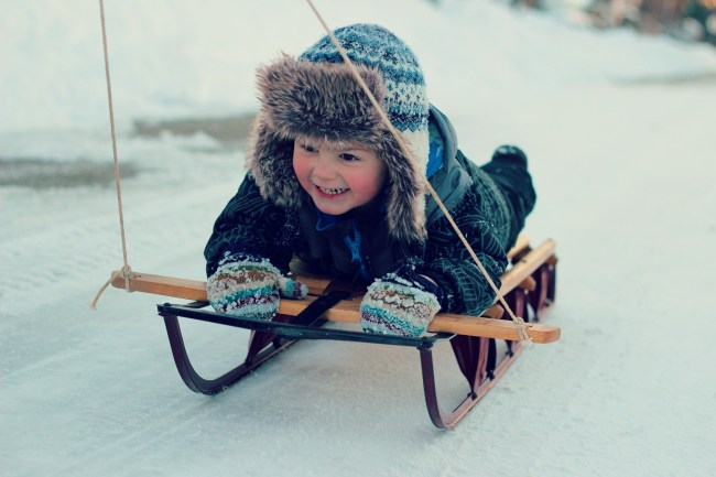 owen smiling sled