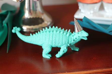 dinosaur figure with silver party hat