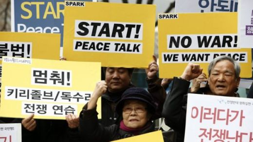 South Korean protesters shout slogans such as