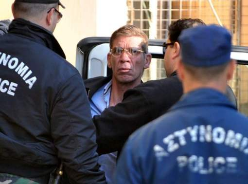 Seif al-Din Mohamed Mostafa, an Egytpian man who hijacked an EgyptAir passenger plane the previous day and forced it to divert to Cyprus demanding to see his ex-wife, is surrounded by policeman as he arrives at the court in Larnaca on March 30, 2016.