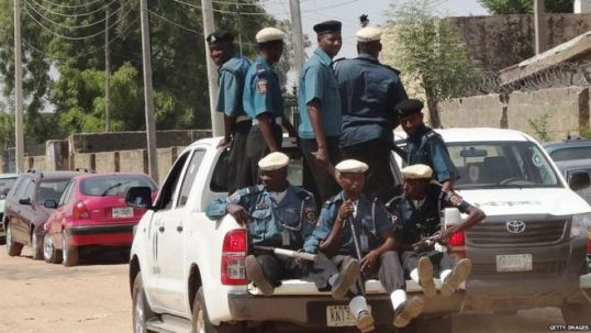 A team of Islamic sharia enforcers called Hisbah is on patrol in the northern Nigerian city of Kano in an open pickup on October 29, 2013.