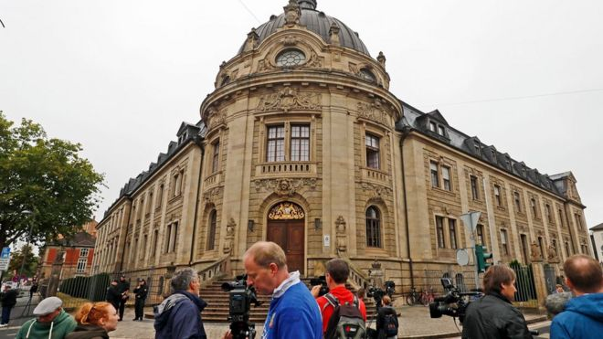 Germany  Migrant jailed for murdering ex girlfriend  15   BBC News Journalists gather in front of the district court building  prior to the  verdict in the