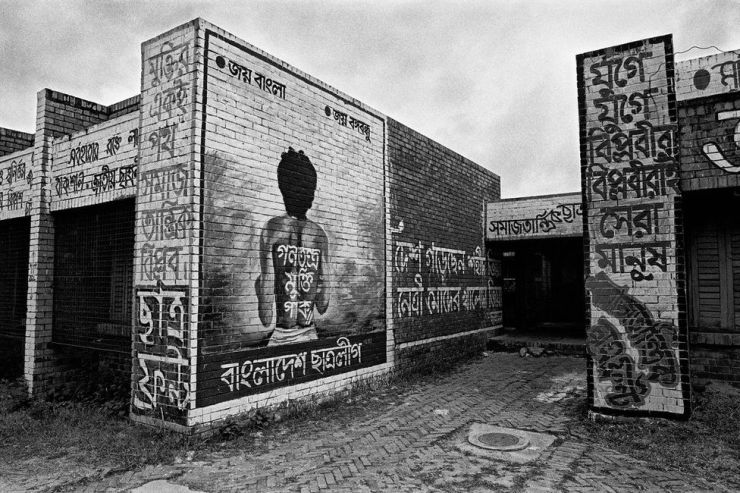Murals on a wall at a university in Dhaka