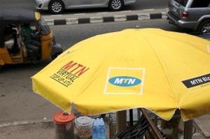 The logo of MTN telecommunication company is seen printed on a umbrella at a call point along a road in Lagos November 16, 2015. Nigeria is standing by a $5.2 billion fine imposed on MTN Group for failing to disconnect unregistered SIM cards though Monday's payment deadline may lapse while a company appeal is considered, Nigeria's telecoms regulator said. REUTERS/Akintunde Akinleye - RTS7EGM