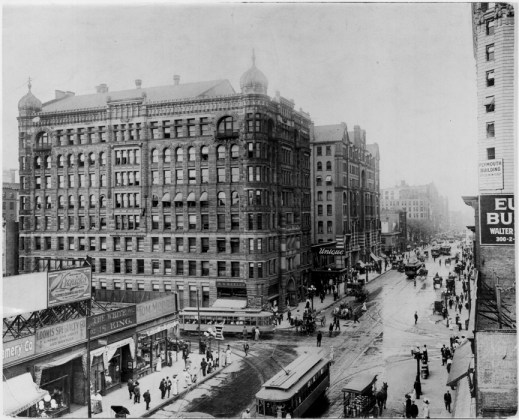 "1911: HENNEPIN AVENUE AT 6TH STREET LOOKING NORTHBusinesses named from left to right. Note milk wagon at bottom right. Date based on construction of Plymouth Building 1910-11. (Steve: Can't tell you how many times I've walked by the intersection and love photos showing ""how it was"")."