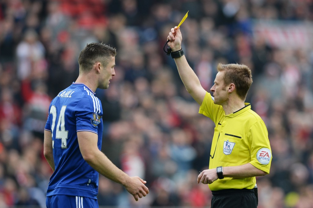 SUNDERLAND, ENGLAND - MAY 07:  Gary Cahill of Chelsea is shown a yellow card by referee Mike Jones during the Barclays Premier League match between Sunderland and Chelsea at the Stadium of Light on May 7, 2016 in Sunderland, United Kingdom.  (Photo by Gareth Copley/Getty Images)