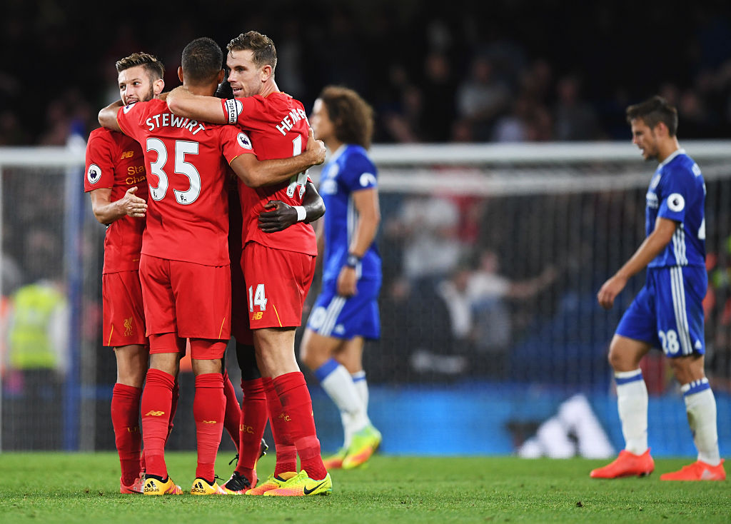 LONDON, ENGLAND - SEPTEMBER 16:  Winning goalscorer Jordan Henderson of Liverpool (14) celebrates victory with Adam Lallana (L) and Kevin Stewart after the Premier League match between Chelsea and Liverpool at Stamford Bridge on September 16, 2016 in London, England.  (Photo by Shaun Botterill/Getty Images)