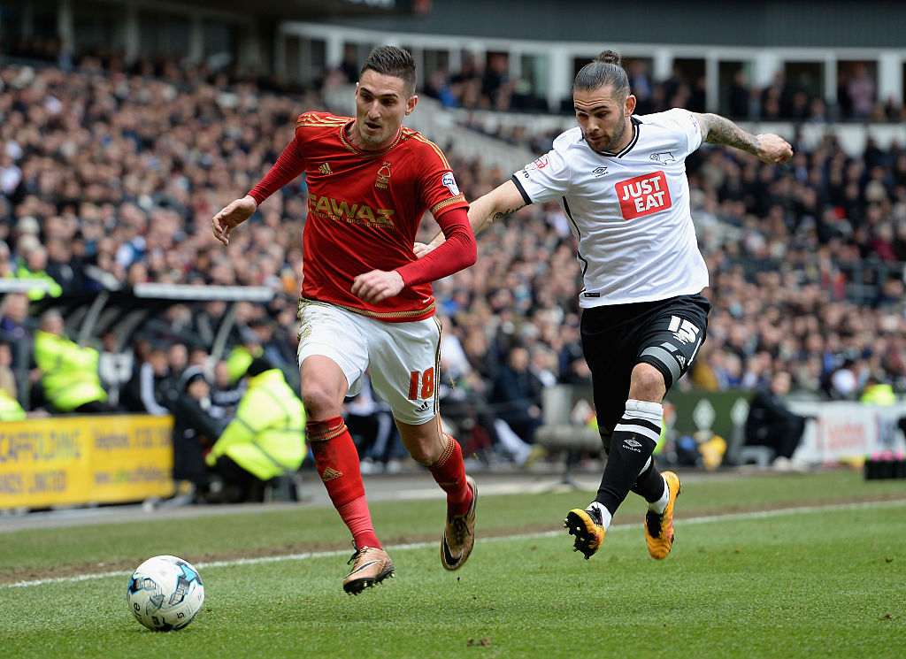 DERBY, ENGLAND - MARCH 19:  Bradley Johnson of Derby County tackles  Federico Macheda of Nottingham Forest during the Sky Bet Championship match between Derby County and Nottingham Forest at the iPro Stadium on March 19, 2016 in Derby, United Kingdom.  (Photo by Tony Marshall/Getty Images)