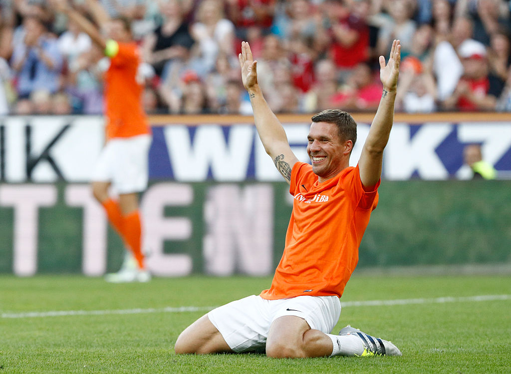 MAINZ, GERMANY - JULY 27:  Lukas Podolski celebrates during the 'Champions for charity' football match between Nowitzki All Stars and Nazionale Piloti in honor of Michael Schumacher at Opel Arena on July 27, 2016 in Mainz, Germany.  (Photo by Andreas Rentz/Getty Images)