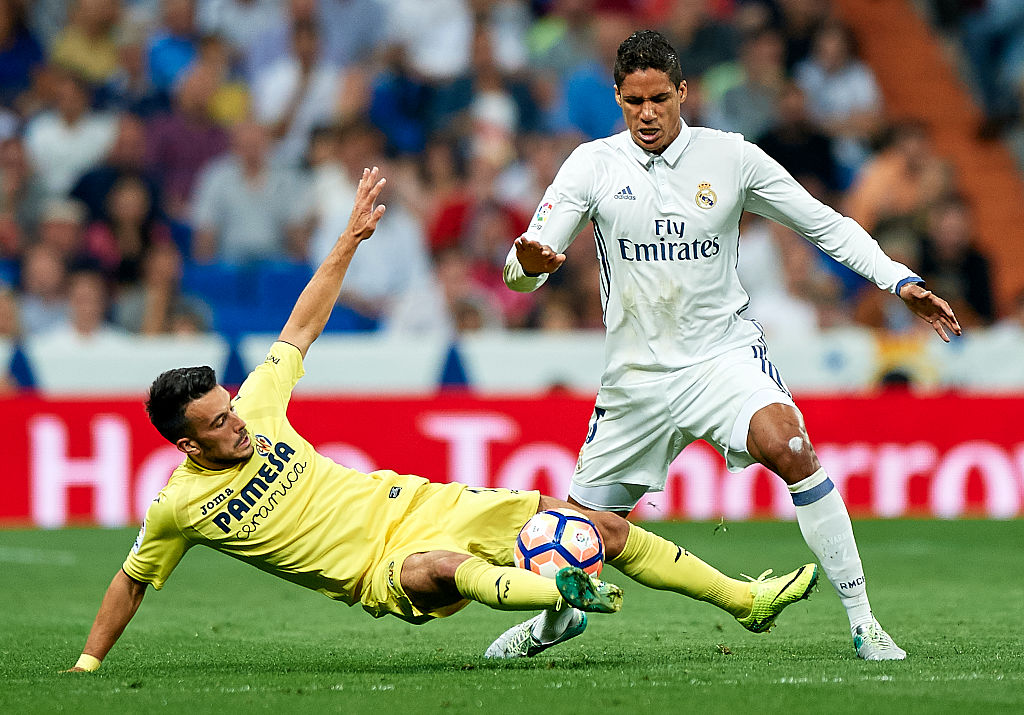 MADRID, SPAIN - SEPTEMBER 21: Raphael Varane of Real Madrid competes for the ball with Nicola Sansone (L) of Villarreal during the La Liga match between Real Madrid CF and Villarreal CF at Estadio Santiago Bernabeu on September 21, 2016 in Madrid, Spain. (Photo by fotopress/Getty Images)