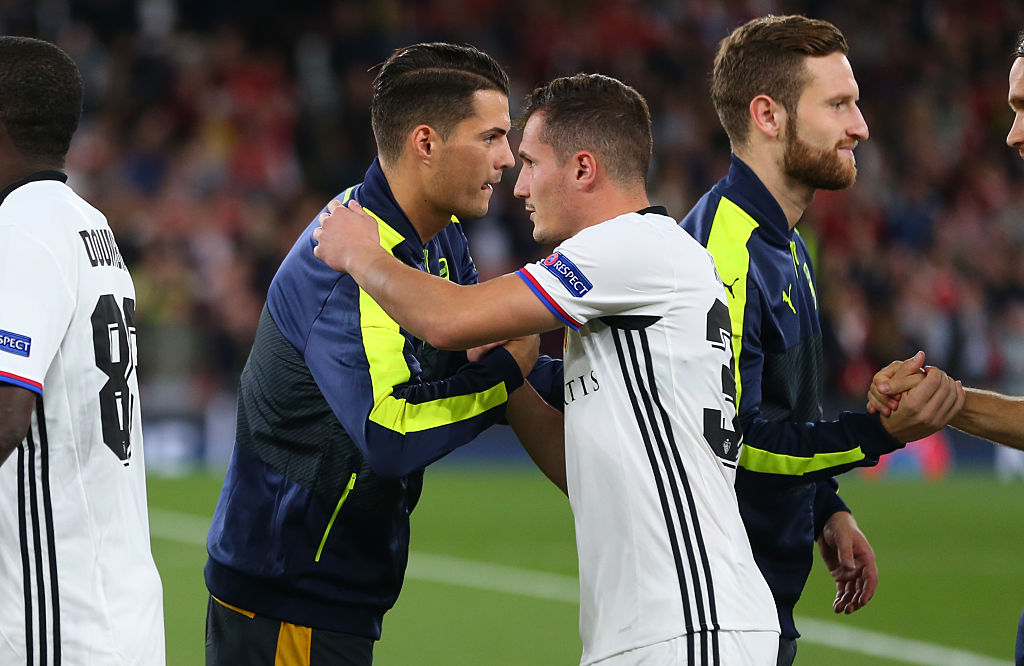 LONDON, ENGLAND - SEPTEMBER 28: Brothers Granit Xhaka of Arsenal and Taulant Xhaka of FC Basel greet each other before the UEFA Champions League match between Arsenal FC and FC Basel 1893 at Emirates Stadium on September 28, 2016 in London, England. (Photo by Catherine Ivill - AMA/Getty Images)