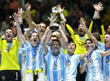 CALI, COLOMBIA - OCTOBER 01:  Fernando Wilhelm of Argentina holds the trophy during the FIFA Futsal World Cup Final match between Russia and Argentina at the Coliseo el Pueblo Stadiumon October 1, 2016 in Cali, Colombia. (Photo by Ian MacNicol - FIFA/FIFA via Getty Images)