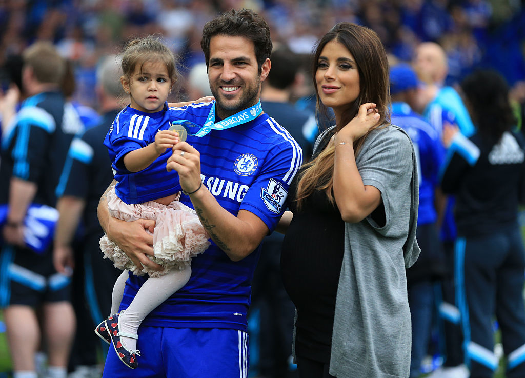 Cesc Fabregas of Chelsea with partner Daniella Semaan as he holds their daughter Lia (Photo by AMA/Corbis via Getty Images)