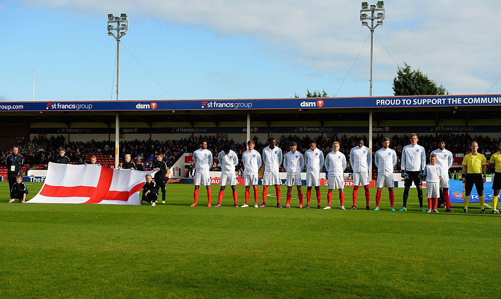 WALSALL, ENGLAND - OCTOBER 11:  Player mascot lines up with the England team for the national anthem during the UEFA European U21 Championship qualifier match between England and Bosnia and Herzegovina at Banks' Stadium on October 11, 2016 in Walsall, England.  (Photo by Tony Marshall - The FA/The FA via Getty Images)