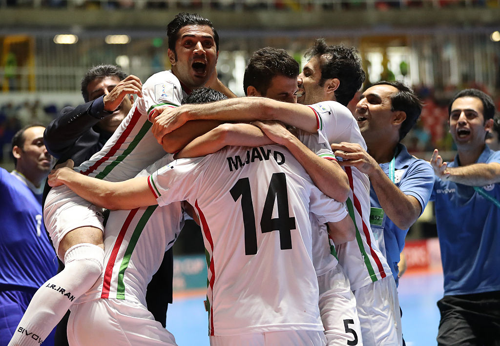 CALI, COLOMBIA - OCTOBER 01:  Mahdi Javid of Iran celebrates after he sores the winning penalty during the FIFA Futsal World Cup Third Place play off  match between Iran and Portugal at the Coliseo el Pueblo Stadium on on October 1, 2016 in Cali, Colombia. (Photo by Ian MacNicol - FIFA/FIFA via Getty Images)