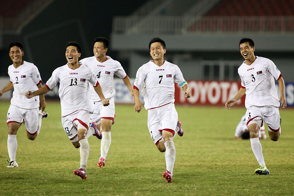 NAY PYI TAW, BURMA - OCTOBER 17:  North Korea players celebrate victory after the penalty shoot out after the AFC U19 Championship quarter-final match between Japan and North Korea at Wunna Theikdi Stadium on October 17, 2014 in Nay Pyi Taw, Burma.  (Photo by CFP/Getty Images)