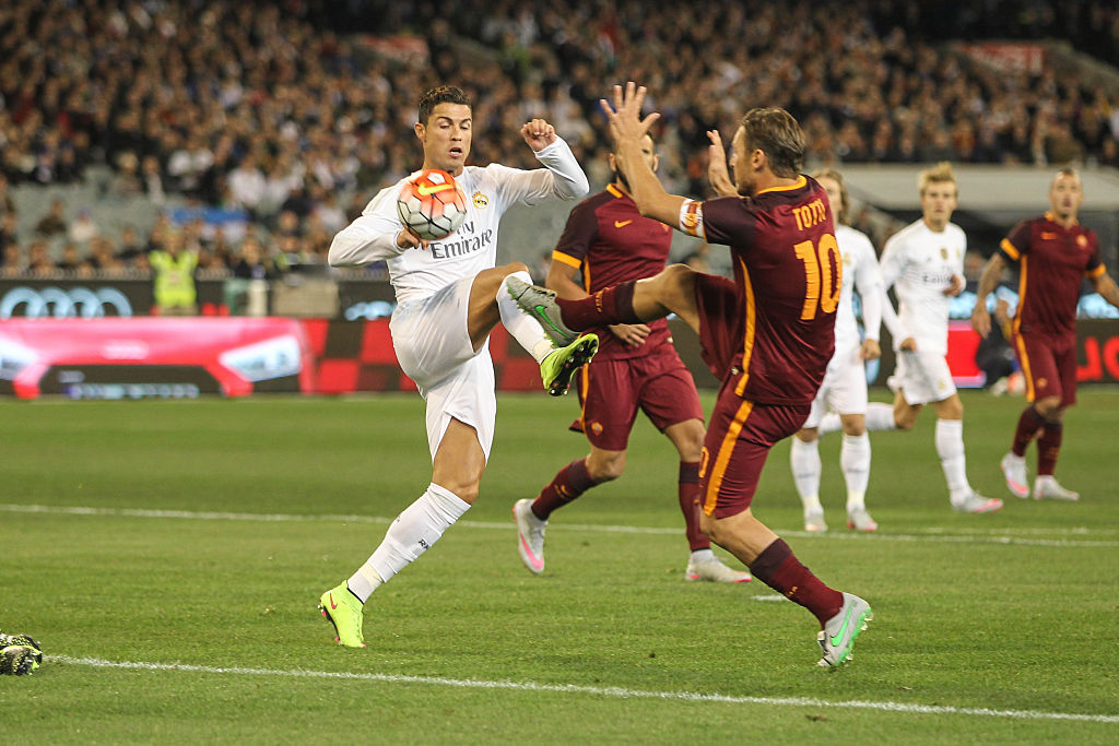 Cristiano Ronaldo takes on Francesco Totti during the ICC Real Madrid vs Roma Game (Photo by David Petranker/Corbis via Getty Images)