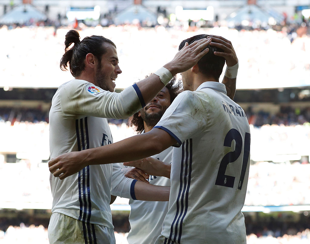 MADRID, SPAIN - NOVEMBER 06:  Gareth Bale (L), Marcelo (C) and Alvaro Morata of Real Madrid celebrate after scoring during the La Liga match between Real Madrid CF and Leganes at Estadio Santiago Bernabeu on November 6, 2016 in Madrid, Spain.  (Photo by Helios de la Rubia/Real Madrid via Getty Images)