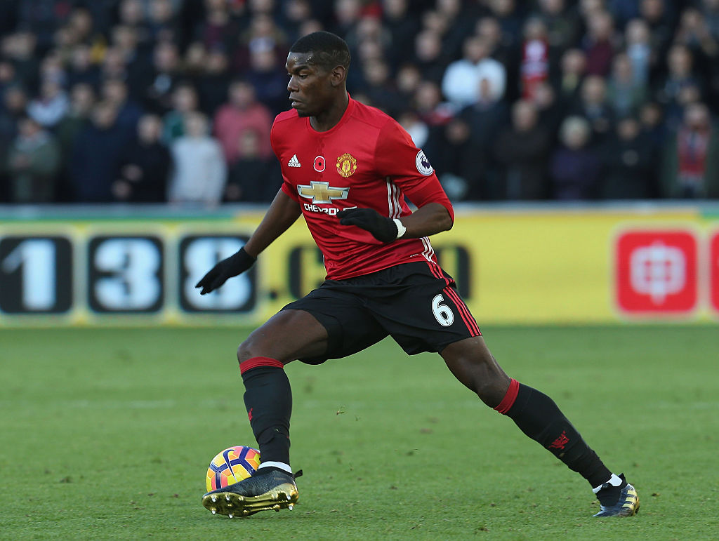 SWANSEA, WALES - NOVEMBER 06:  Paul Pogba of Manchester United in action during the Premier League match between Swansea City and Manchester United at the Liberty Stadium on November 6, 2016 in Swansea, Wales.  (Photo by Matthew Peters/Man Utd via Getty Images)