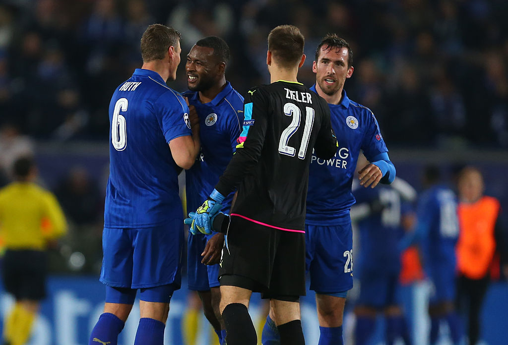 LEICESTER, ENGLAND - NOVEMBER 22: Wes Morgan of Leicester City celebrates with Robert Huth, Ron-Robert Zieler and Christian Fuchs of Leicester City after the UEFA Champions League match between Leicester City FC and Club Brugge KV at The King Power Stadium on November 22, 2016 in Leicester, England. (Photo by Catherine Ivill - AMA/Getty Images)