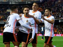 VALENCIA, SPAIN - DECEMBER 04: Alvaro Medran of Valencia celebrates scoring his team's second goal with his teammates Joao Cancelo (L), Rodrigo Moreno (2R) and Munir El Haddadi (R) during the La Liga match between Valencia CF and Malaga CF at Mestalla Stadium on December 04, 2016 in Valencia, Spain. (Photo by Manuel Queimadelos Alonso/Getty Images)