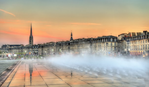 Famous water mirror fountain in front of Place de la Bourse in Bordeaux, France