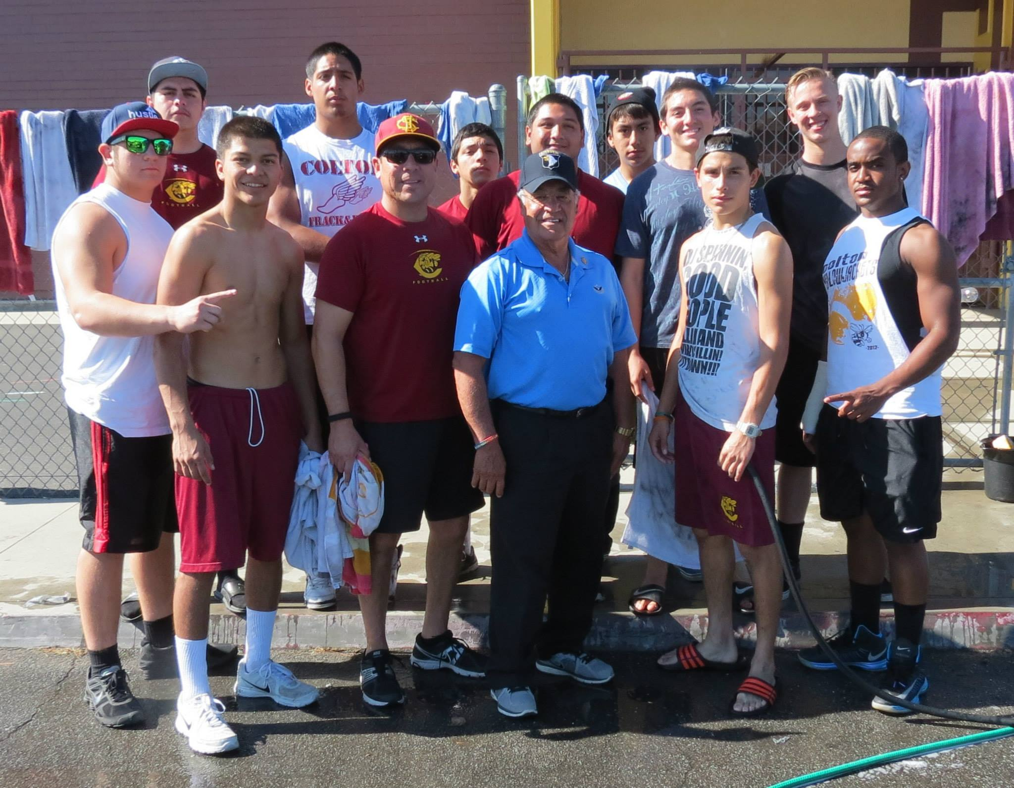 Colton High School football players with former U.S. congressman Joe Baca, Sr. (center).
