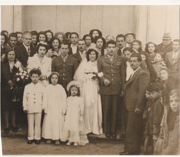 Courtesy Photo  John and Angelina's wedding, performed by the Bishop of Italy in 1944. Most of the people in the photo were townspeople of Madeloni, Italy, that showed up to watch the unprecedented marriage,