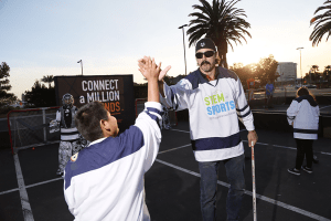 courtesy photo/boys and girls clubs  Retired Ducks right wing George Parros taught members of the Boys & Girls Clubs the science and math behind hockey during Time Warner Cable's STEM in Sports event at the Honda Center in Anaheim on Jan. 13.
